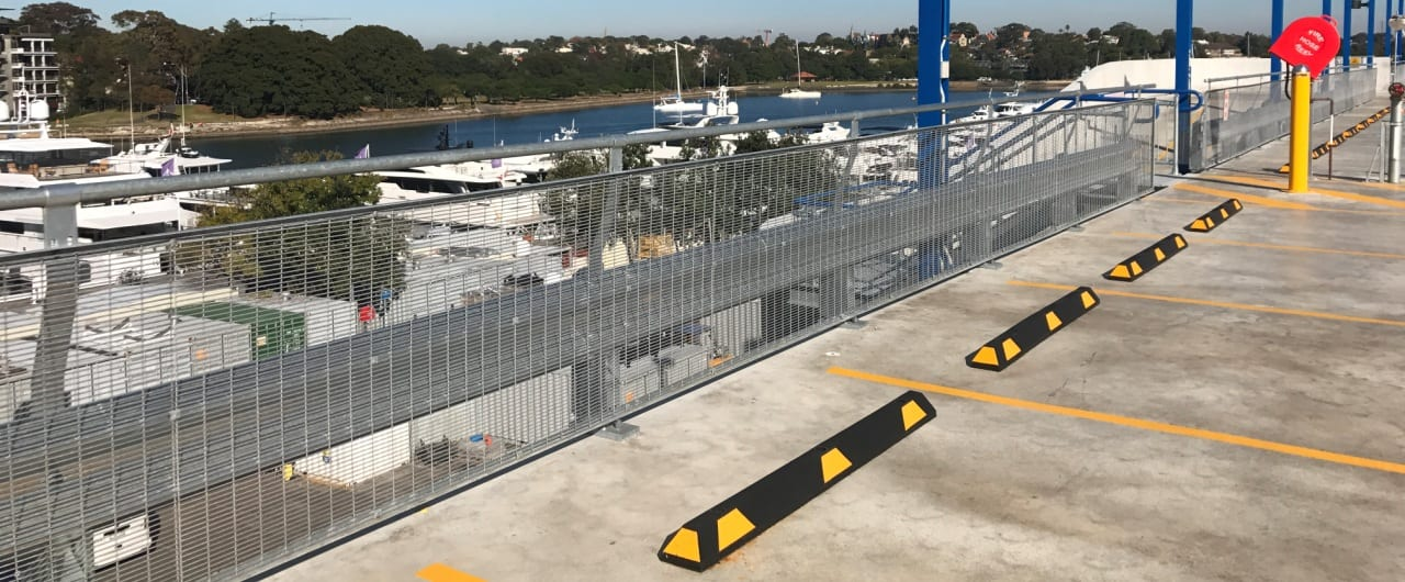 rhino stop sky edge with mesh infill and handrail installed at sydney marina