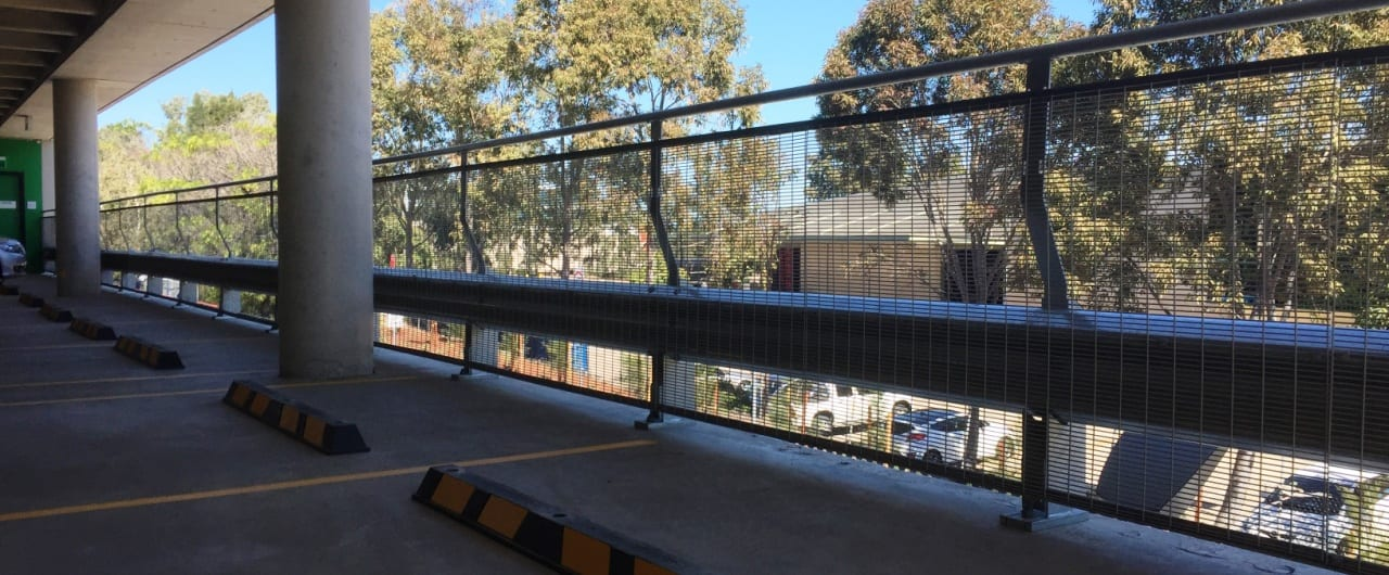 rhino stop with mesh infill and handrail installation at woolworths carpark