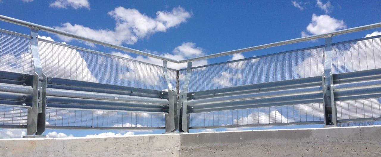 rhino stop type 4 with mesh infill and handrail installed at coles torronga carpark