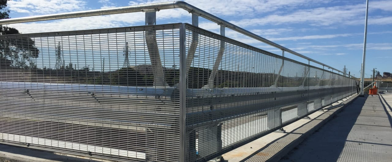 rhino stop configured with mesh infill and handrail installed at endeavour energy carpark