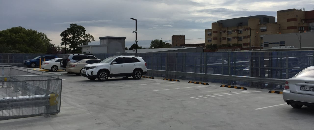 rhino stop type 4 with mesh infill and handrail installed at lismore hospital carpark