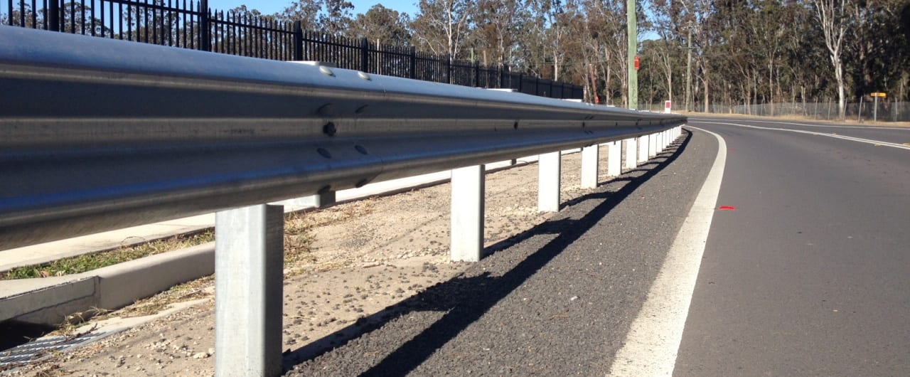 curved guardrail to suit the contours of reconciliation road