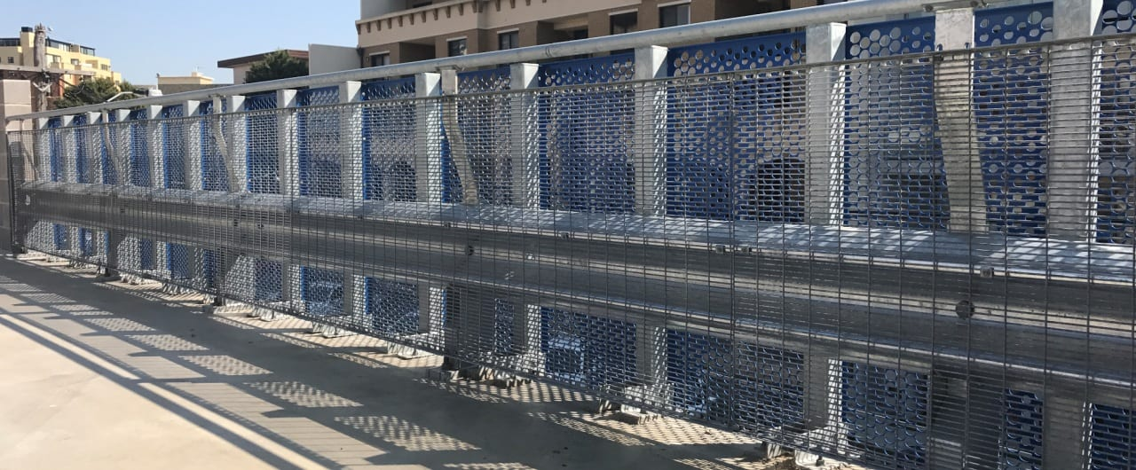 rhino stop sky edge with mesh infill and handrail installed at st george hospital car park