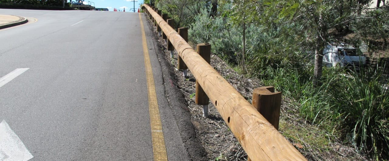 t18 log rail installation on the queensland roadside