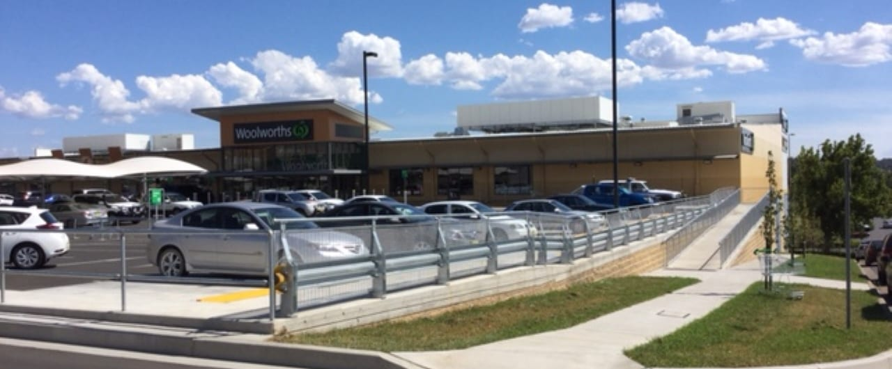 rhino stop with mesh infill and handrail installation on tamwoth retail development car park