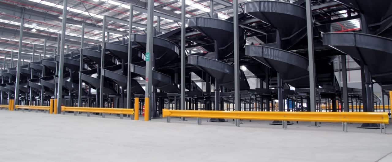 conveyor system protection with rhino stop barrier at toll warehouse