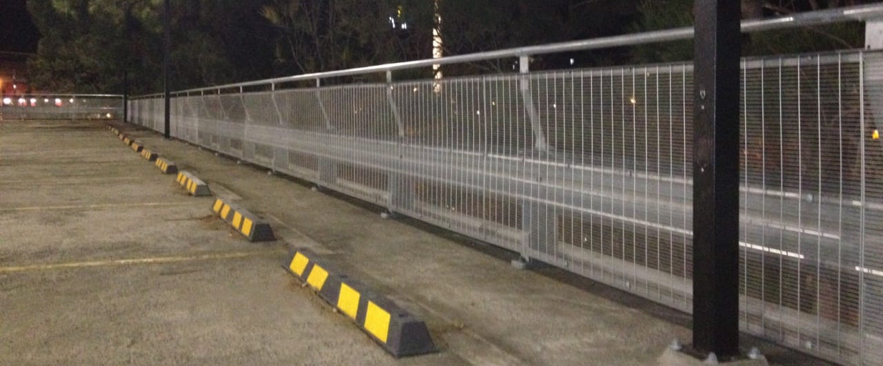rhino stop configured with mesh infill and handrail installed at wollongong council car park