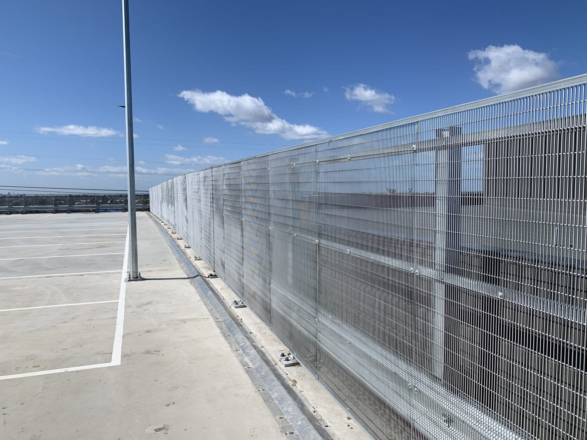 rhino stop screen installation on the upper deck car park building
