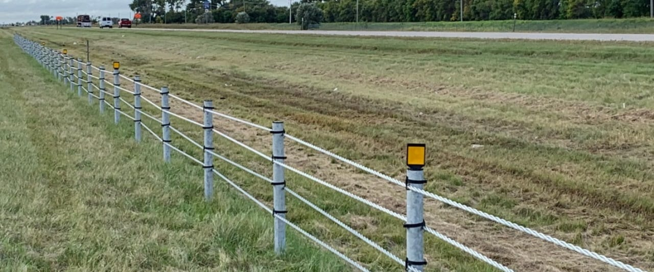 tubular post for wire rope safety barrier